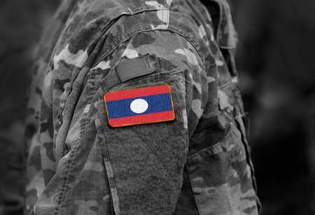 Flag of Laos on soldiers arm. Flag of Laos on military uniforms (collage).