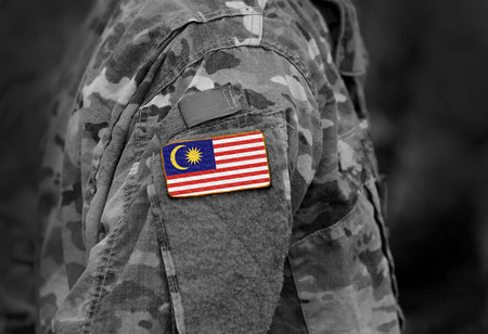 Flag of Malaysia on soldiers arm. Flag of Malaysia on military uniforms (collage).
