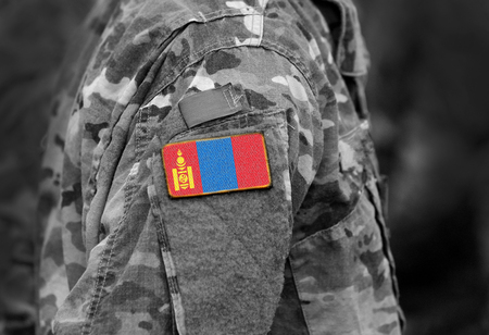 Flag of Mongolia on soldiers arm. Flag of Mongolia on military uniforms (collage). Reklamní fotografie