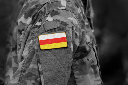 Flag of South Ossetia on soldiers arm. Flag of South Ossetia on military uniforms (collage).