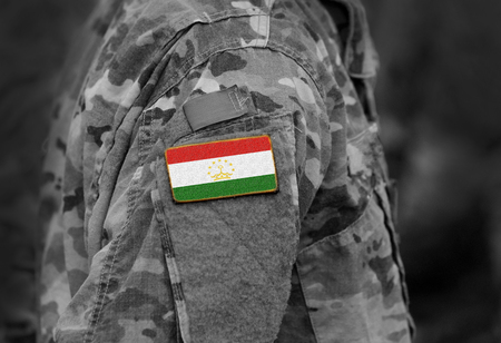 Flag of Tajikistan on soldiers arm. Flag of Tajikistan on military uniforms (collage). Reklamní fotografie