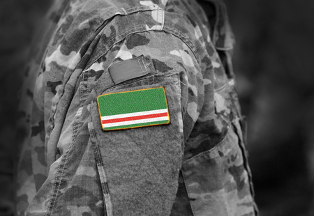Flag of Chechen Republic of Ichkeria on military uniforms. Flag of Chechen Republic of Ichkeria on soldiers arm.  (collage).