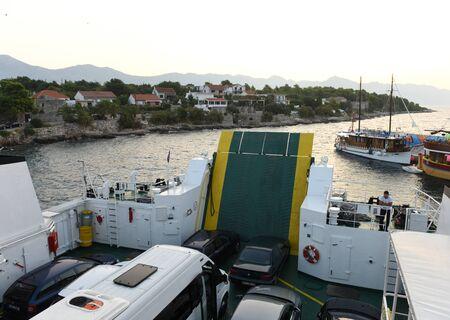 Sucuraj, Croatia - August 2018:  Ferry Jadrolinija in port Sucuraj  on island Hvar, Croatia Stock Photo - 136696199
