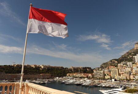 Flag of Monaco waving at the centr of  Monaco. 版權商用圖片