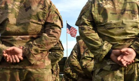 American Soldiers and Flag of USA. US Army. Veteran Day 版權商用圖片