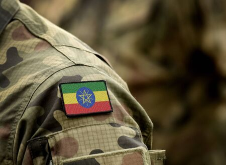 Flag of Ethiopia on military uniform. Army, troops, soldiers, Africa,(collage). Standard-Bild