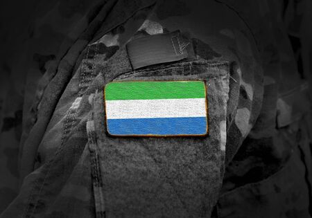 Flag of Sierra Leone on military uniform. Army, troops, soldiers, Africa, (collage).
