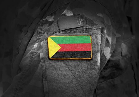 Flag of Azawad on soldiers arm. Flag of State of Azawad on military uniforms. Army, troops. Collage.