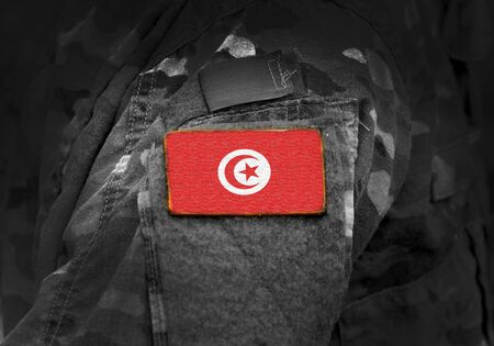 Flag of Tunisia on military uniform. Army, troops, soldiers. Collage.