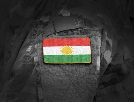Flag of Kurdistan on soldiers arm. Flag of Kurdistan on military uniforms (collage).