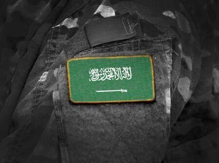 Flag of Saudi Arabia on military uniforms (collage).