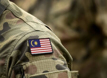 Flag of Malaysia on military uniform. Army, troops, soldiers. Collage. Stock fotó