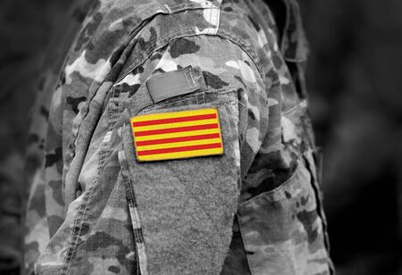 Flag of Catalonia (Senyera) on military uniform. Collage. Foto de archivo