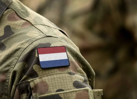 Flag of Netherlands on military uniform (collage).