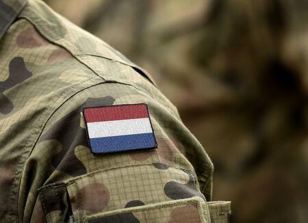 Flag of Netherlands on military uniform (collage). Banque d'images - 133997545
