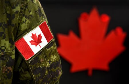 Canada Day. Flag of Canada on the military uniform and red Maple leaf on the background. Canadian soldiers. Army of Canada. Canada leaf. Remembrance Day. Poppy day.