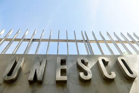 Paris, France - August 30, 2019:The logo of the United Nations Educational, Scientific and Cultural Organization (UNESCO) on the main UNESCO building in Paris, France.