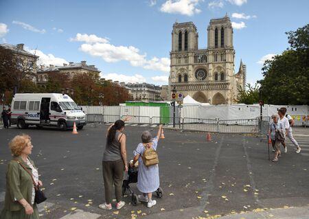 Paris, France - September 1, 2019: People near the Cathedrale Notre-Dame de Paris in Paris, France.