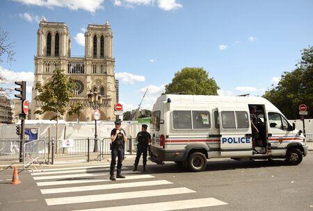 Paris, France - September 1, 2019: Police near the Cathedrale Notre-Dame de Paris in Paris, France.