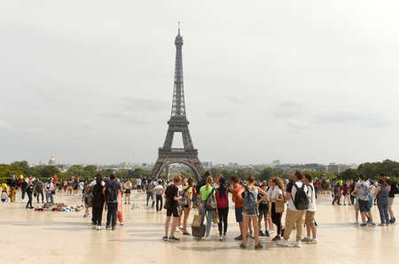 Paris, France - August 28, 2019: A crowd of people on Trocadero near the Eiffel Tower in Paris. Éditoriale