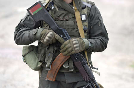 Flag of Belarus on assault rifle  .  Military, army, armed forces, soldiers. Collage.