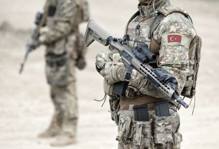 Soldiers with assault rifle and flag of Turkey on military uniform. Collage.