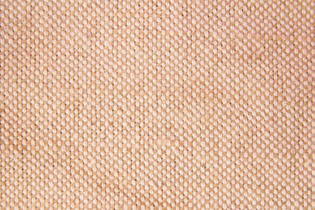 neutral beige linen fabric background with texture close up