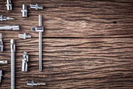 Working tools on wooden table background close up