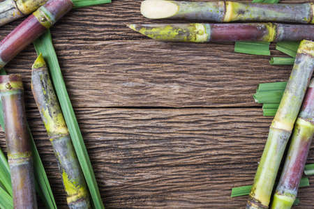 Close up sugarcane on wood background close up