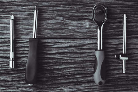 working tools on wooden background. color effect.