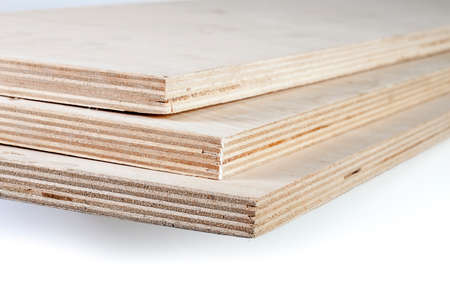 three light plywood boards stacked on top of each other