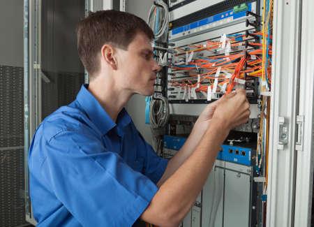 senior  Network engineer in server room wokinig Standard-Bild