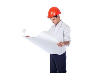 man in a shirt orange construction helmet with blueprints photo