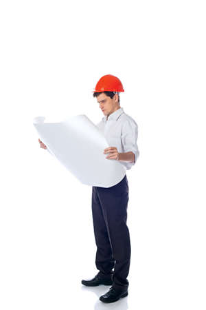 man in a shirt orange construction helmet with blueprints photo