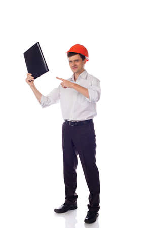 Man in a shirt orange construction helmet with one hand holdi photo