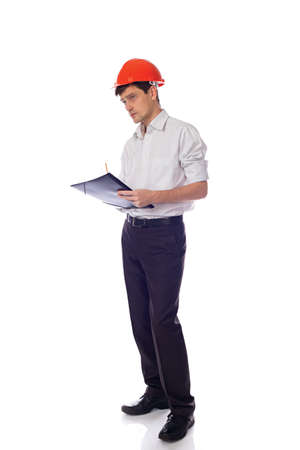 Man in a shirt orange construction helmet writes black folder photo