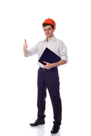 Man in a shirt orange construction helmet holding black folder photo