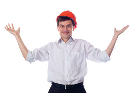 Man in a shirt orange construction helmet, throws up his hands photo