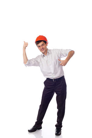 Man in a shirt orange construction helmet, thumbs up isolate photo