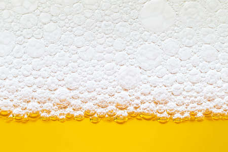 Close up border between the beer and foam in glass
