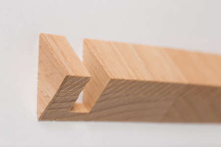 Abstract elements Wooden blocks, decorative cut in a tree, close-up on a white background Standard-Bild