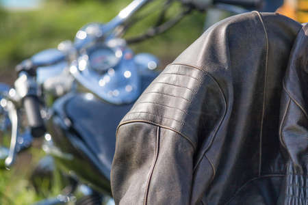 leather jacket in the focus on motorcycle chopper, bokeh of chrome Standard-Bild