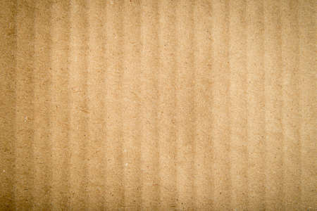 The texture background striped brown cardboard, vignetting