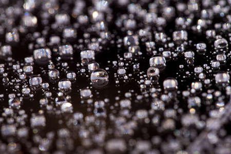 the Abstract black-white background with gradient color water drops on glass with reflection, bockeh, macro Standard-Bild