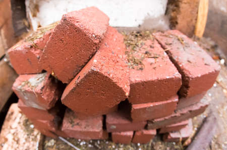 pile of red brick on the construction site geometrical distortions fish eye