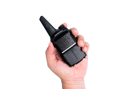 The hand of a man holding a transceiver or walkie-talkie.on white background or isolated