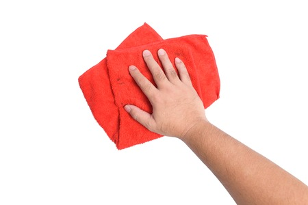 A mans hand Using red rags wipe on white background or isolated Stock Photo