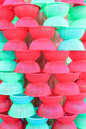 Red and green plastic cone-shaped cover or cowl cover food for background Stock Photo