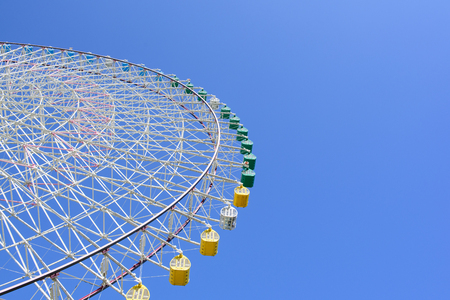 Colorful of Giant Ferris Wheel with blue sky at Osaka, Japan