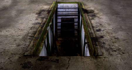 The descent into the pit in the concrete floor
